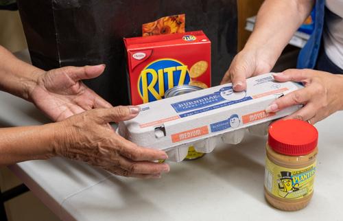 hands passing food to hands